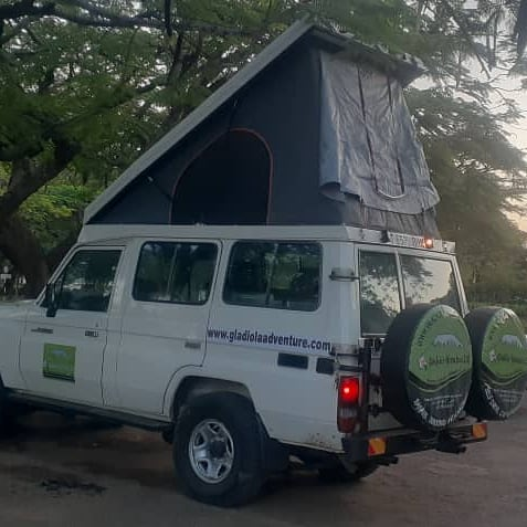 Gladiola Adventure Toyota Land-cruiser hardtop with a fixed rooftop tent for rent and self-drives in Tanzania